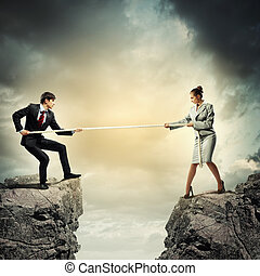 People pull the rope. - Confrontation between two business...
