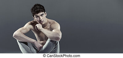 Handsome athlete with curly hair - Handsome young athlete...