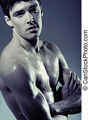 Muscular young man without T-shirt - Muscular young guy...