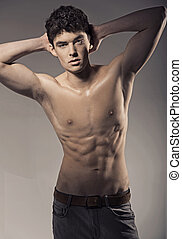 Young handsome athlete in nice pose - Young handsome athlete...