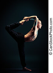plasticity - Handsome man shows different yoga exercises...