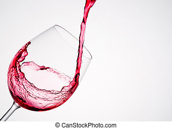 Wine pouring into a glass in diagonal composition and white...
