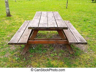 Table and benchs outdoors - Table and benchs in a park. An...
