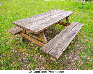 Table and benchs in a park outdoors