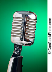 Classic microphone isolated on green background