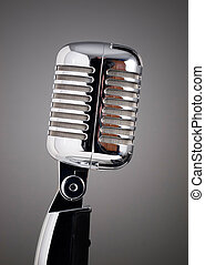 Classic microphone on grey