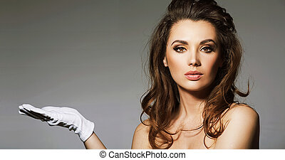 Portrait of alluring brunette lady with classic gloves
