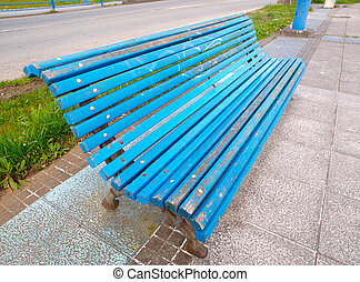 Blue bench in diagonal composition.