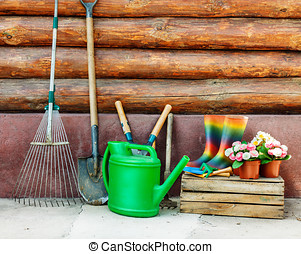 Garden tools photo against wooden wall