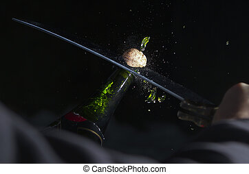 Sabrage - Opening a Champagne bottle with a sabre for...