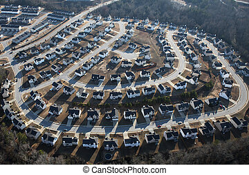 Suburban Sprawl - Suburban sprawl housing track in late...