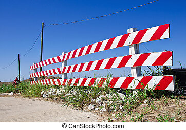 Road barrier at a construction or road work site