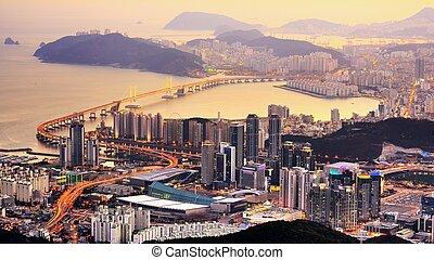 Busan, South Korea - Skyline of Busan, South Korea at night.