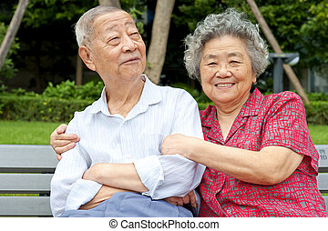 an intimate senior couple embraced - happy senior couple...