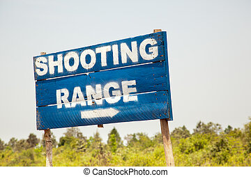 Shooting Range Sign - A blue sign directs tourists to the...