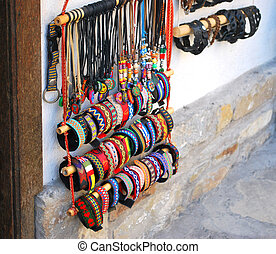 colorful bracelets and necklaces with beads - row of...