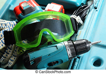 Drill, gloves and goggles in the box