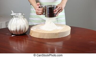 Flour Sifter - Sifting flour with a sift