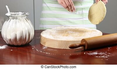 Dough Rolling - Flatten out dough with a rolling pin.