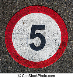 Nr. 5 - round speed limit sign on the street. Prohibited to...