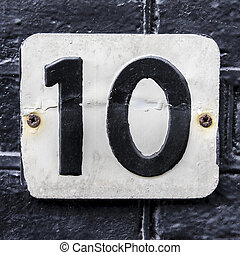 Nr. 10 - house number 10 embossed in a metal plate