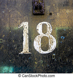 Nr 18 - House number eighteen, deteriorated white lettering...