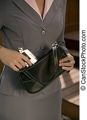 Woman with a gun - Woman with a concealed gun in her purse