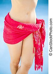 female torso in a red sarong - Torso of a woman wearing a...
