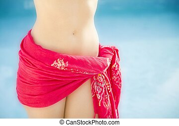 female torso in red sarong - Torso of a woman wearing a red...