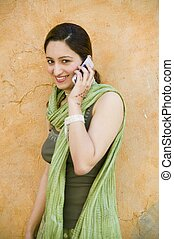 Indian / Pakistani girl on cell phone - An Indian /...