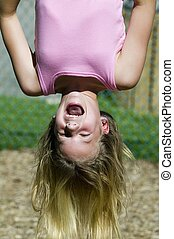 Blond girl hanging upside down