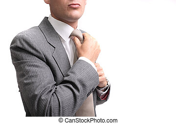 ready to work - young businessman fastening tie