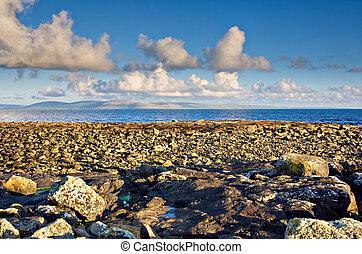 Galway Bay in Ireland with The Burren in the background