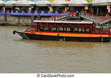 Tourist bumboat on Singapore River - A tourist river cruise...