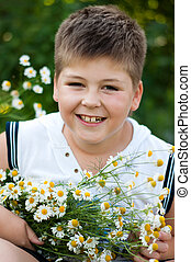 Boy with field daisies