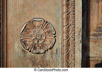 Carved Tudor Rose on a vintage doorway - Carved Tudor Rose...