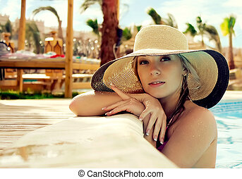 Portrait of the girl in a hat - The smart blonde in a hat in...