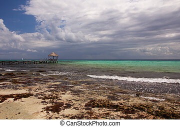 Clouds Gather over Caribbean Beach - Stormclouds gather of a...