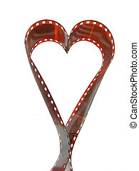 Photo film heart - Heart made from old photo film isolated...