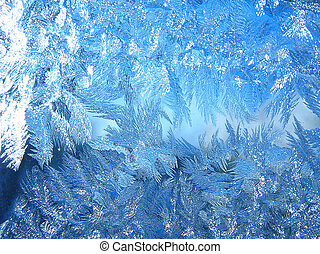 Ice background - Frozen winter window with patterns of ice