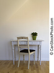 old chair and table against white wall