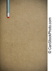 blue pencil on vintage packing paper background - pencil on...