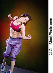 dance girl - young woman in sport dress dancing zumba