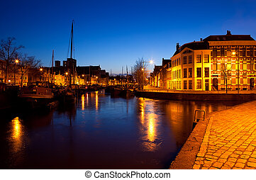 ships on canal in Groningen at night - ships on canal in...