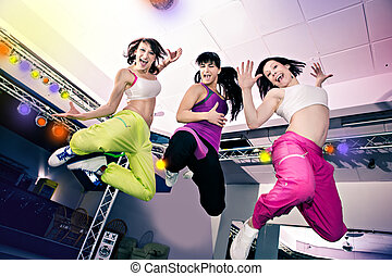 aerobics girls - young women in sport dress at an aerobic...