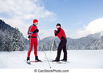 cross-country skiing - two men cross-country skiing in front...