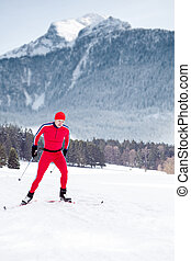 cross-country skiing - A man cross-country skiing in front...