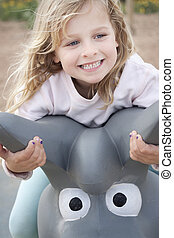 Girl smiling at the playground - Close up of a child on a...