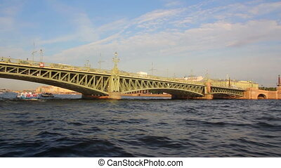 Trinity Bridge on Neva river in St. Petersburg Russia - timelapse shooting from boat