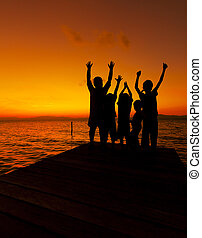 Silhouette of children at sunset